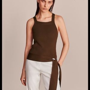 Textured top with tie detail. NWT